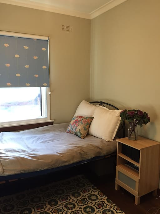 Second bedroom with 1x king-single bed. Cot facilities and change table available upon request.