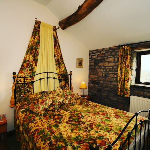 King size bedroom with wonderful view across the valley