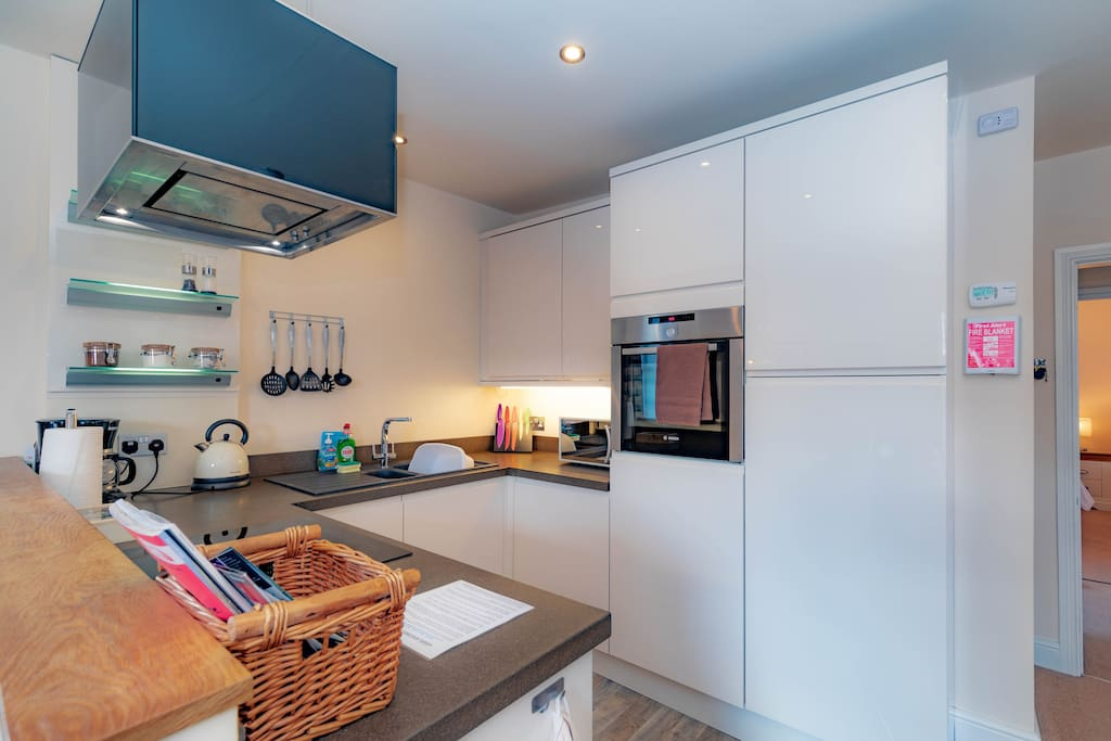 Kitchen - Clean, fresh and modern. There is a good supply of kitchenware and appliances, and a dedicated wine fridge!