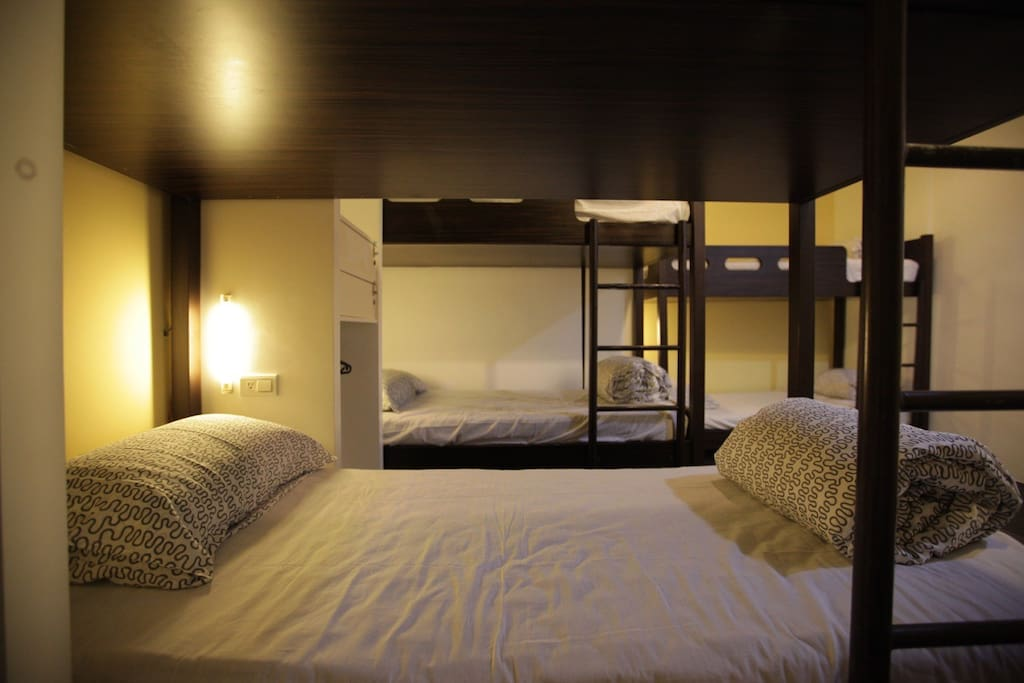 Each bed equips with a bedside lamp and a wall socket.