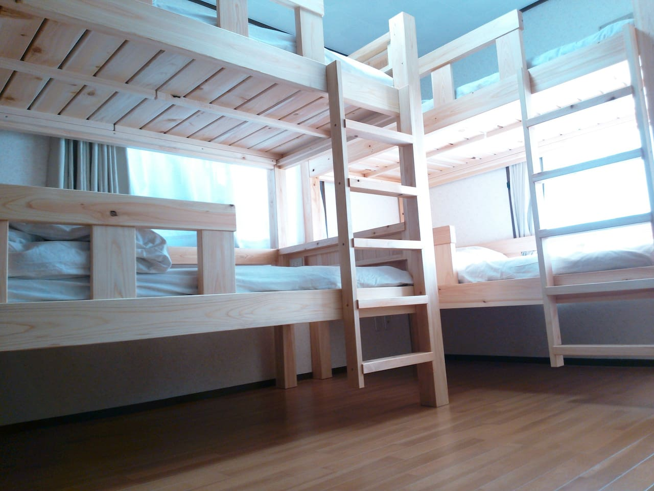 Bunk beds . Two windows . Bright 4 people room .