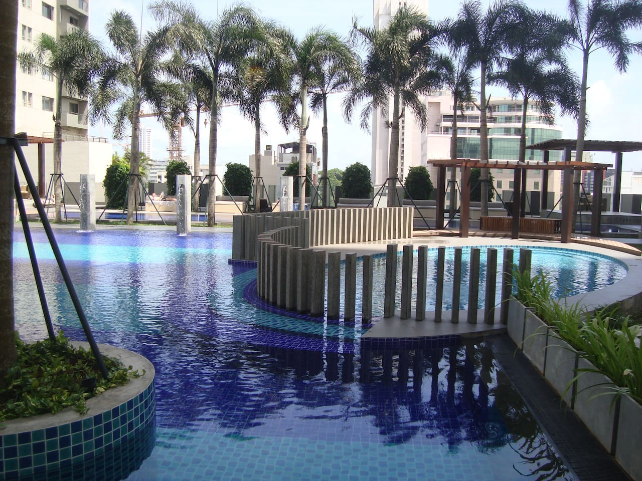 Swimming Pools in Palm fringed landscaped garden