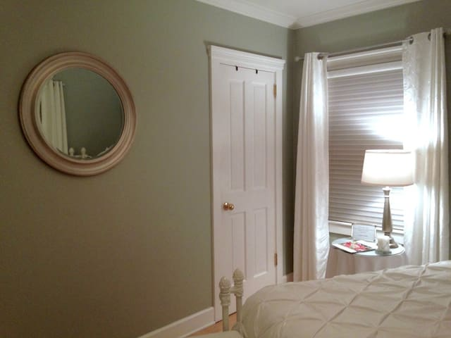 The mirror reminds us of a porthole on a cruise ship.
