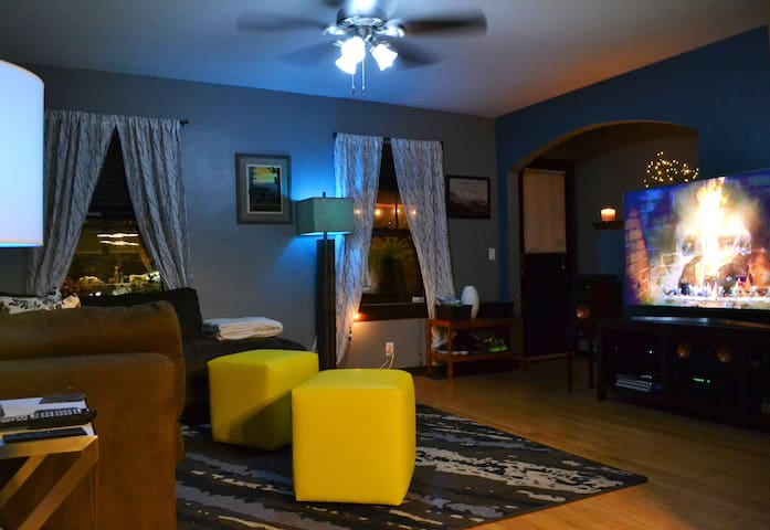 "Living room at night with the ""hue lightbulbs"" switched over to ""arctic aurora"" blue :)."