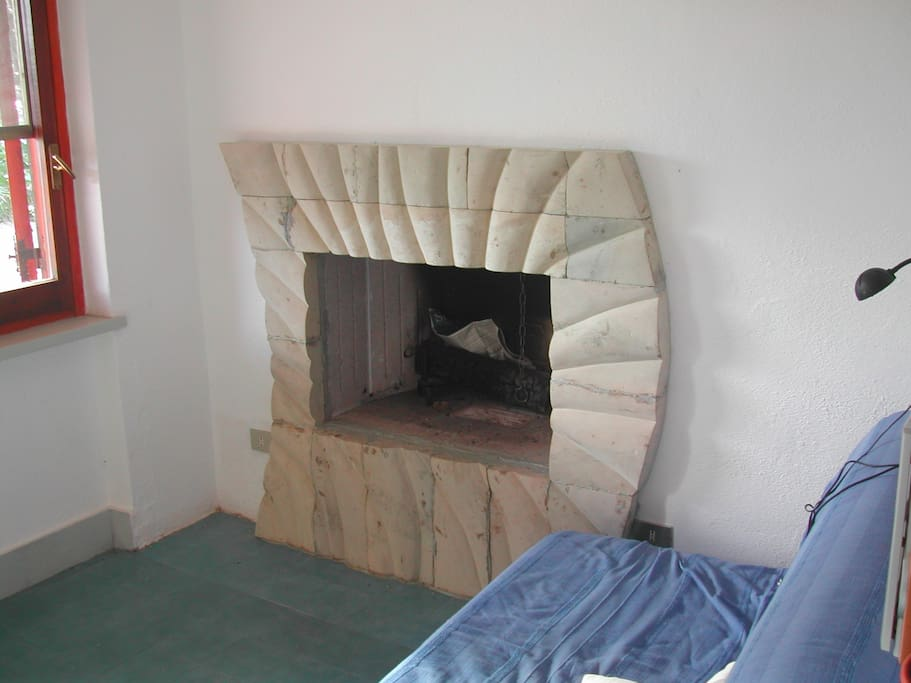 fireplace, done by a friend, local artist
