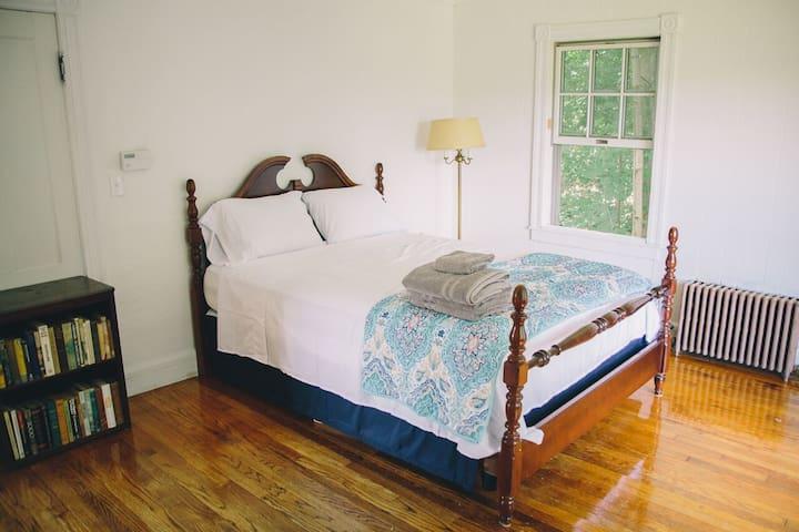 Bedrooms overlook trees and ravine