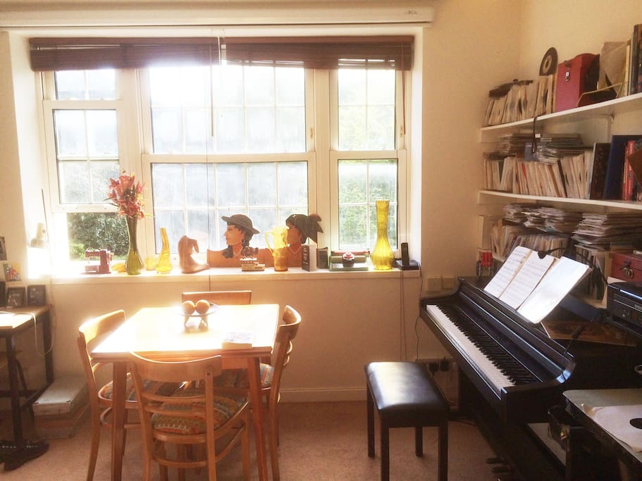 Piano and Extendable dining room table.