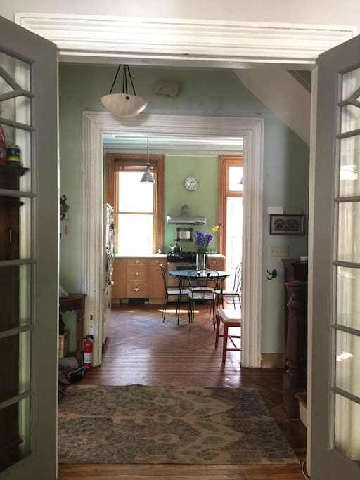 View of kitchen and entry way from living room