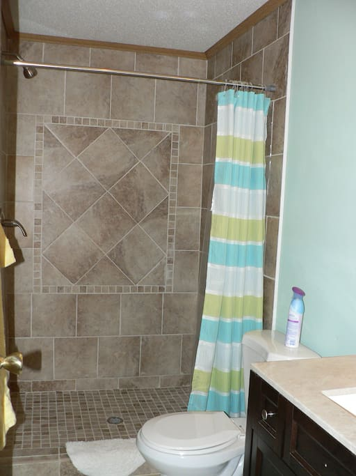 New Tile Showers in each Bathroom