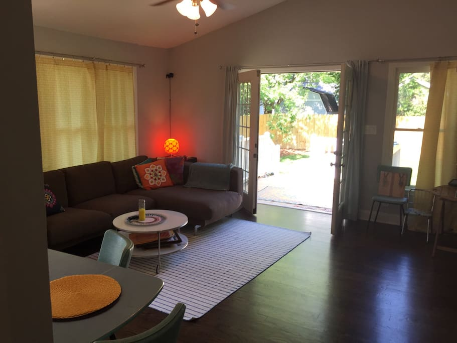 Large, sunny front living room and dining room with french doors.