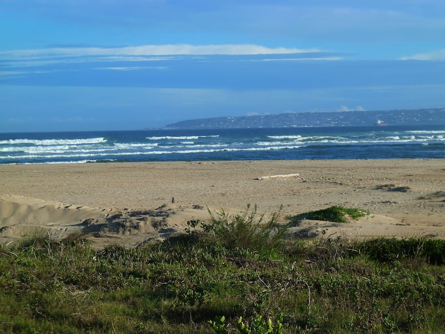 Blue Status beach with Mossel Bay in the back ground. Wonderful safe swimming.