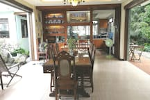 Breakfast is served in the open style dining room with the view of the garden and the cool air blowing from both sides.