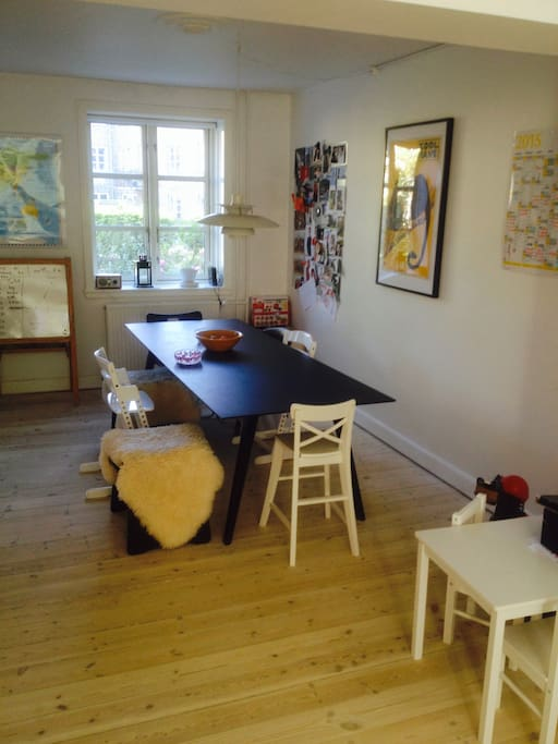 open living room/ kitchen with dining table with seating for 6-8 people