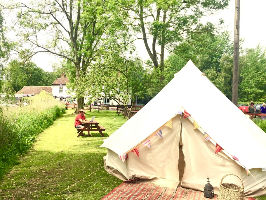 The bell tents are near the pub