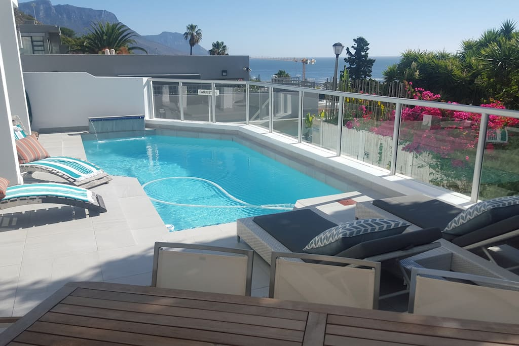 Private pool deck with 8 seater table