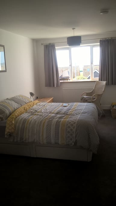 Large bedroom with view across the bay to Portland