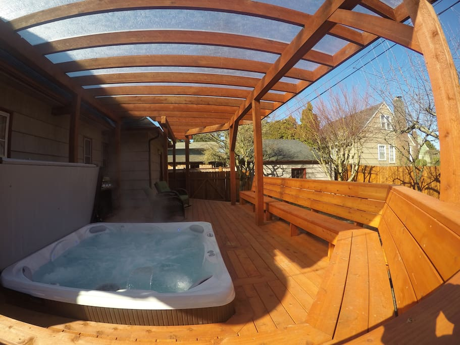 Brand new hot tub under covered deck