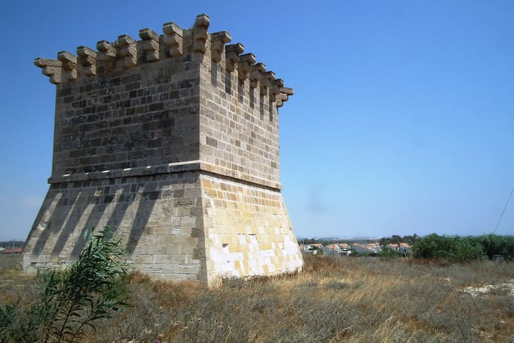 The medieval watch tower is overlooking the estate