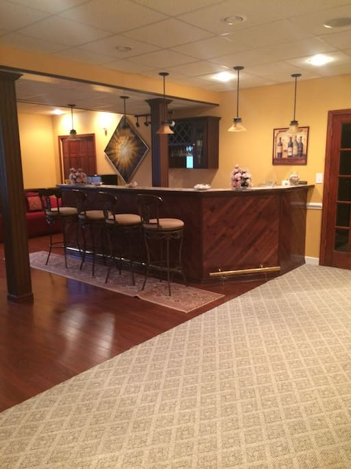 Full Bar with fridge, kitchenette, dishware, glasses, and cleaning supplies.