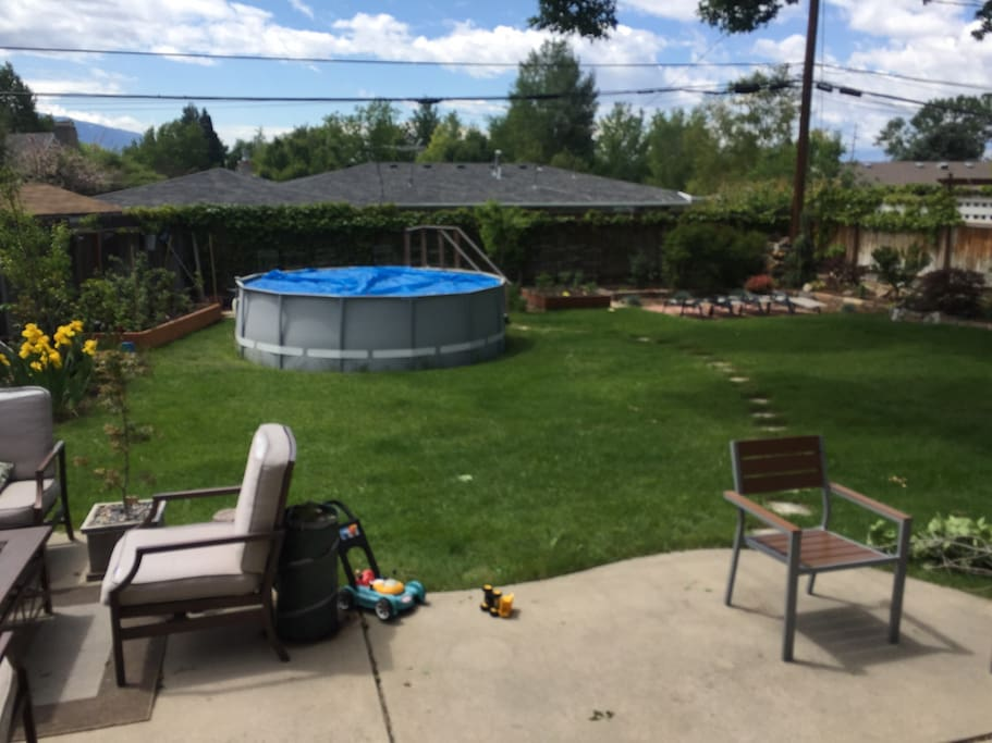 Pool and chaise lounges. There are raised box garden planters behind the pool that are loaded with heirloom tomatoes in the summer. Feel free to enjoy them with fresh basil!