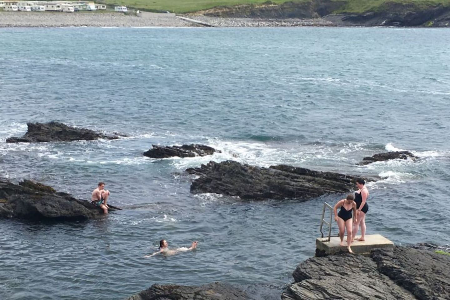 Have a dip in Kieran's Hole at the White Strand Beach