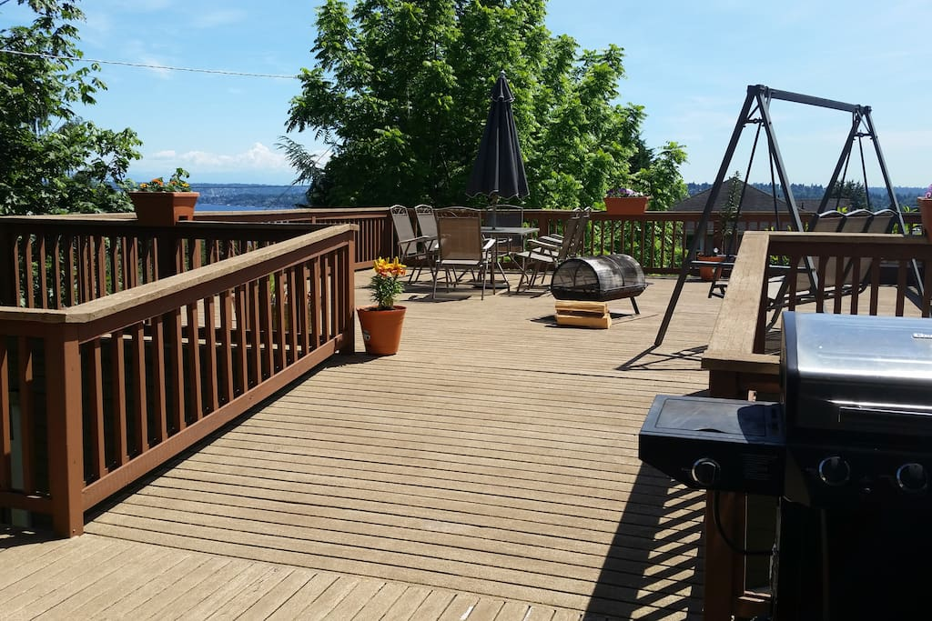Large view deck for entertaining with grill, patio swing, fire pit and dining table