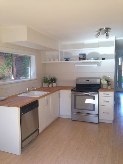 Welcome to your bright, open concept garden level suite in East Vancouver.  Kitchen features stainless steel appliances (including dishwasher), butcher block countertops, a big farmhouse style sink and bright white tiles and walls.