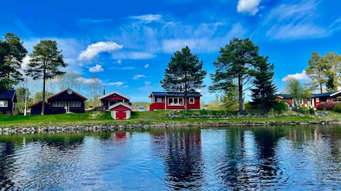 2 charming waterside cabins with boat