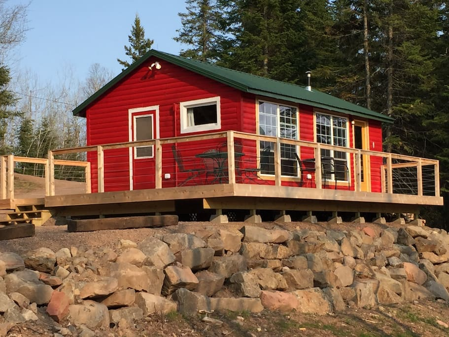 Cabin Brooke has a large deck, grill and plenty of outdoor seating to enjoy the river and Tettegouche Park views.