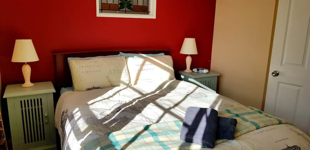 Downstairs queen bedroom (bathed in gorgeous winter sunshine).
