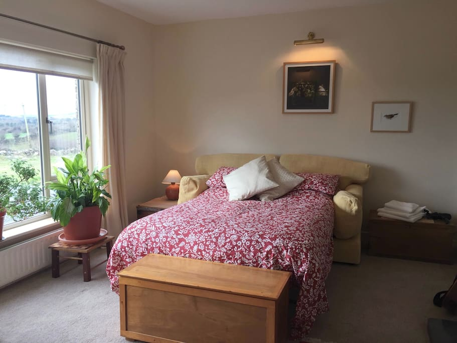 Spacious room with comfortable bed and amazing Burren views