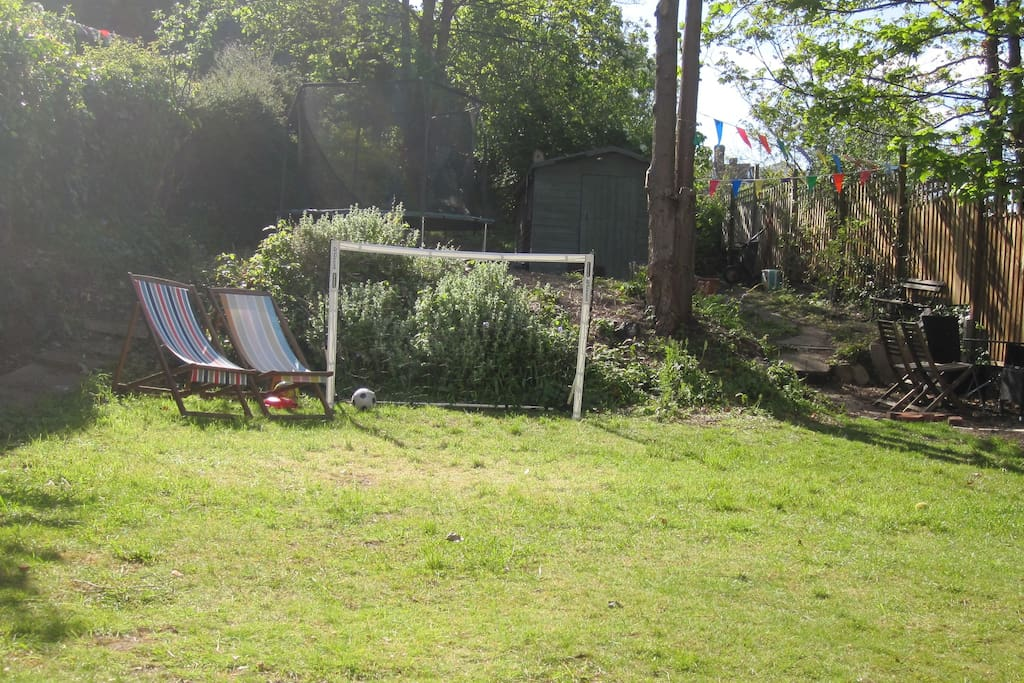 You're in goal! The large garden has a trampoline, slide and tyre swing!