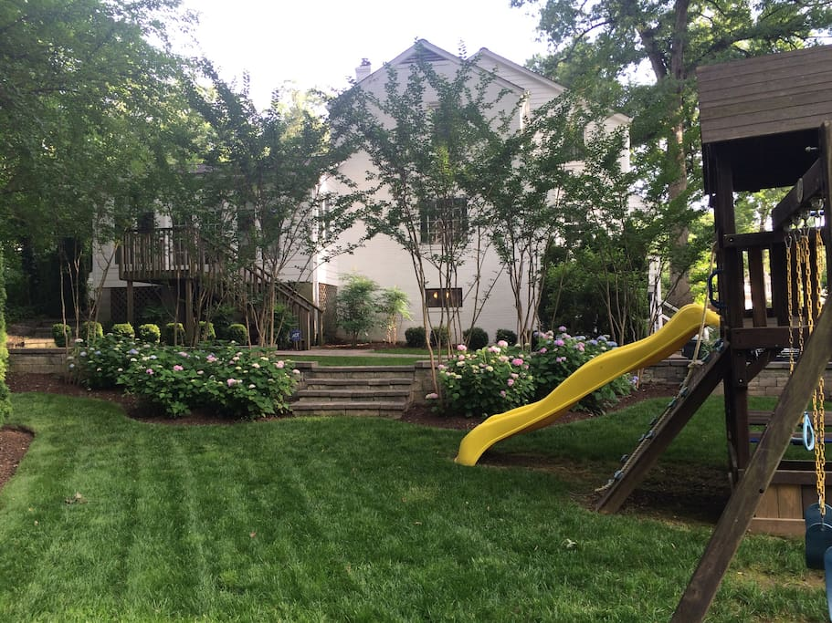 Backyard with large kids play structure