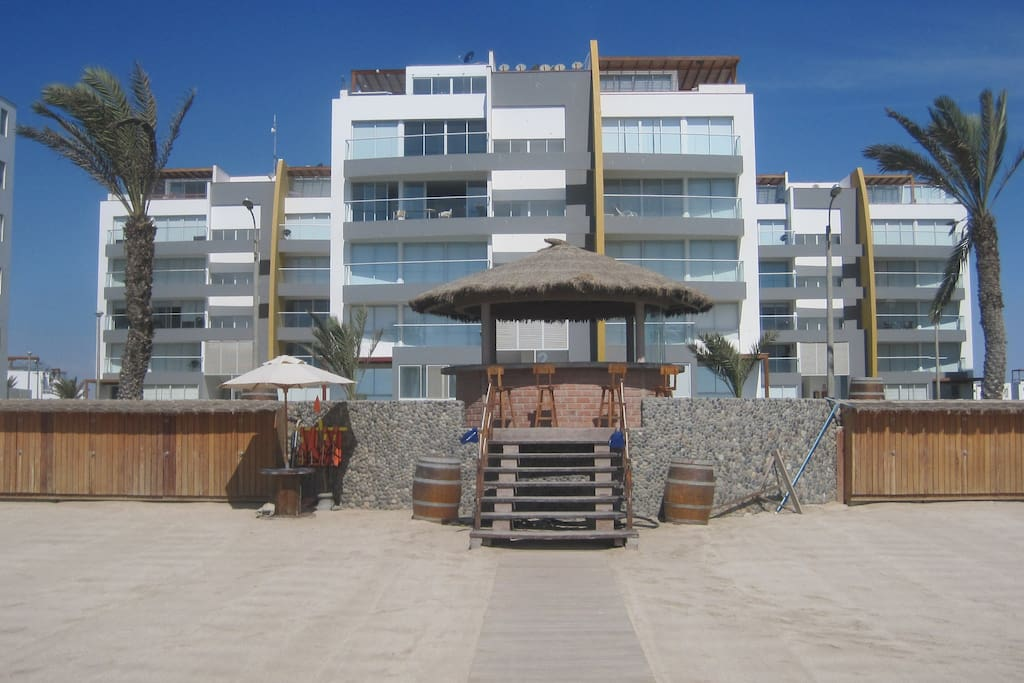Front view of the apartment building  from the beach