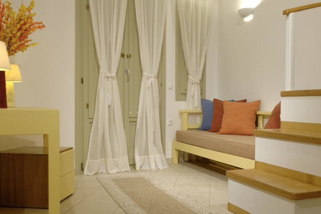 Irida Santorini - Apt. 3 - lower level with kitchenette, sitting area and bathroom.