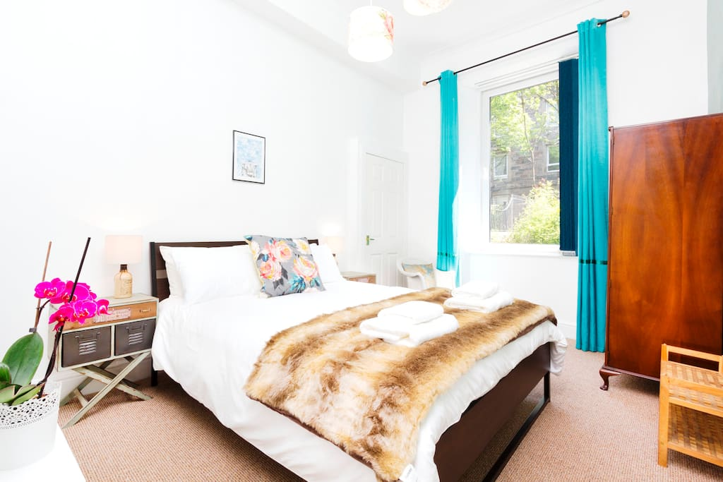 A spacious master bedroom with European King sized bed (6Ft 6 by 5Ft 2)