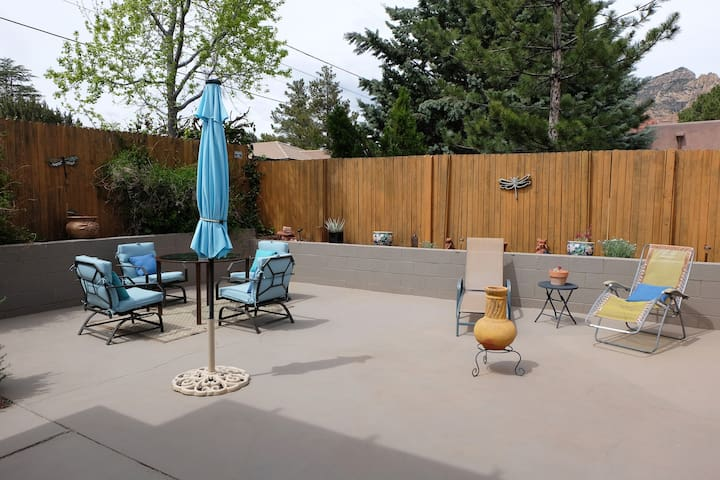 Beautiful oversized patio with three sitting areas (one area covered) surrounded by red rock formations.  Light a fire—cook outside on portable electric grill—or simply relax.