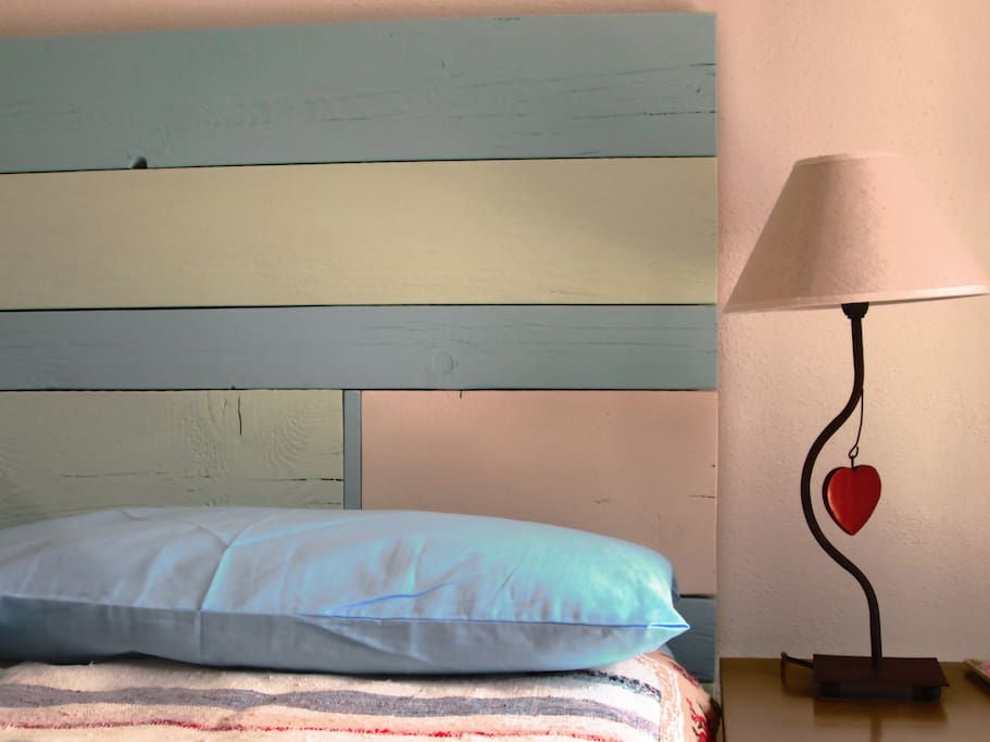 old boards repurposed as headboard