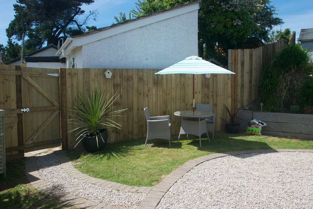 View of the front garden. Private, and with a sunny spot to dine.