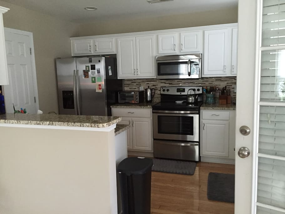Stainless steel appliances and granite counter tops.