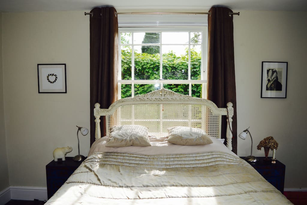 Spacious bedroom with kingsize bed.