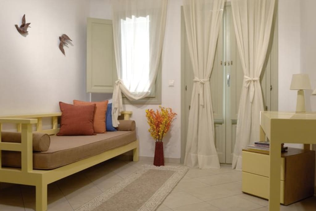 Irida Santotini - Apt. 5 - lower level with kitchenette, sitting area and bathroom