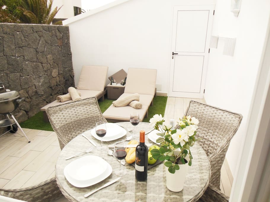Outside Courtyard with Table, Chairs, Sunloungers and BBQ