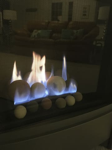 Cosy up to the Indoor gas fireplace