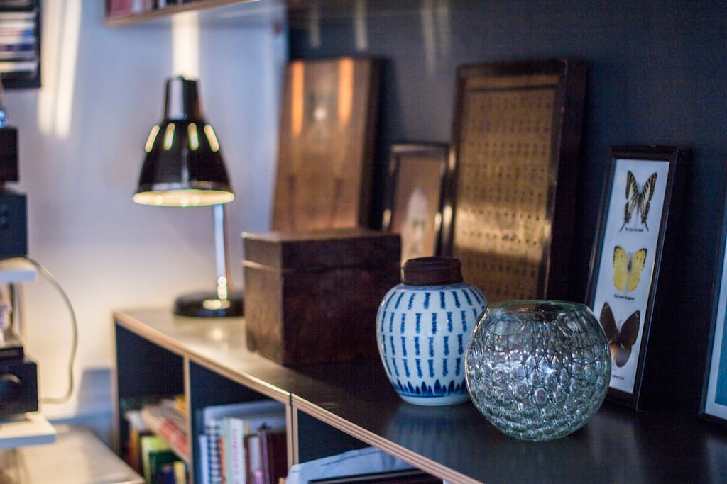 Detail from the bookshelf with our favorite things.