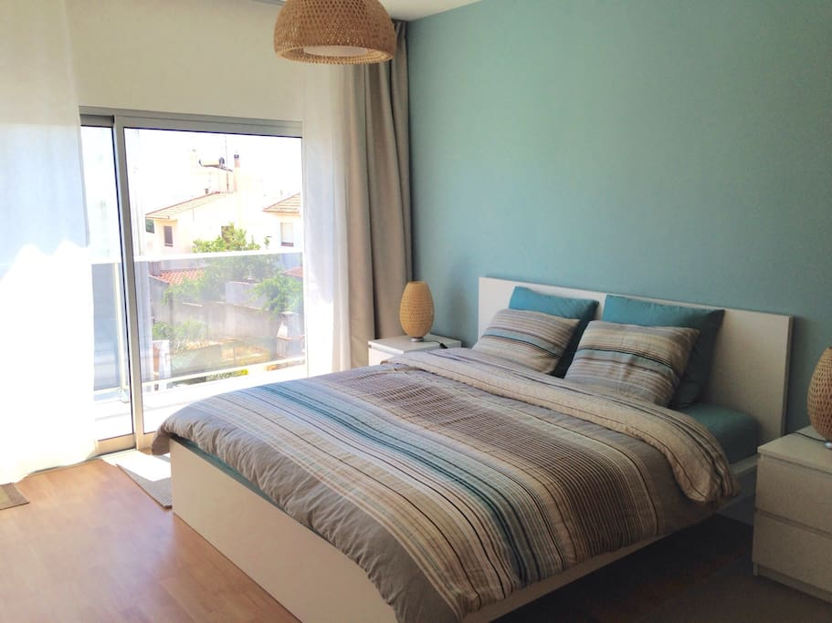 Master bedroom with a balcony and AC