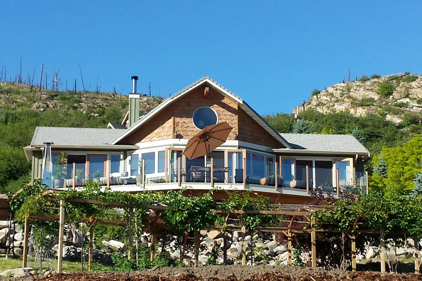 Our home is on the hillside overlooking the largest view possible of the lake Okanagan