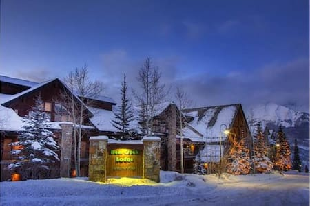 Bear Creek Lodge at Mountain Village is situated adjacent to the Telluride Ski Resort. Use of the Lower Village Bypass run and a semi-private lift provides access to the slopes within in minutes. This property offers a free shuttle to anywhere in Mountain Village as well as a fitness center, indoor and outdoor hot tubs, an outdoor heated pool, and a sauna. The luxurious Bear Creek Lodge accommodations are the perfect option for family or group Telluride vacation.  Business Licence #014927 Bear Creek Lodge #105A is a one bedroom, one bathroom unit facing the mountainside located on the 1st floor of the building. The master bedroom has a king bed that splits into two twins, TV and an ensuite bathroom with jetted tub and separate shower. The living room has a gas fireplace with a queen sleeper sofa for extra sleeping space. Amenities include a fully-equipped kitchen with microwave and refrigerator, flatscreen TV, private laundry, and high speed internet access.  Photos are representative of the property and may differ from the actual unit that is reserved.