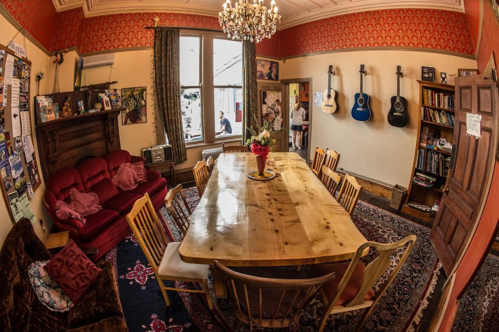 Cozy dining room with handmade wooden table and guitars.
