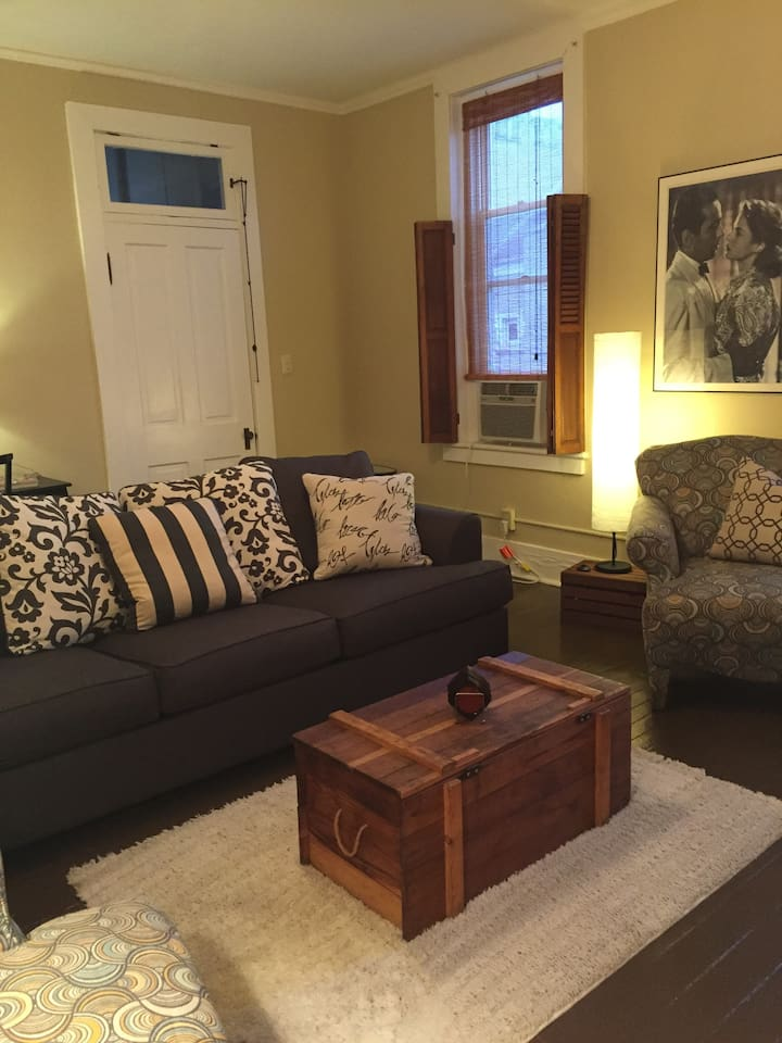 Living room is comfortable with a couch and two chairs